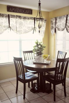 Living Room/Dining Room/Kitchen Window Treatment Idea... Curtain- use cheap curved rod, sew a pocket into the fabric and add grosgrain ribbon. Done.
