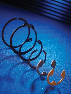 Retaining Rings, Snap Rings & Circlips  SIZES: Over 800 sizes available MATERIALS: Carbon spring steel, Stainless steel, Phosphor Bronze, Beryllium copper, Various plate finishes & many more TYPES: Metric & Imperial: Internal, External, E-clips, Wire rings, Snap rings KITS: Metric & Imperial: Kits & Top-up Bags available ASSOCIATED PRODUCTS: Kit Branding, Stack Feeders, O-Clips, Circlip & Pliers