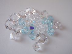 Swarovski Elements Crystal Clear and Blue Bicone by Spasojevich, $4.00