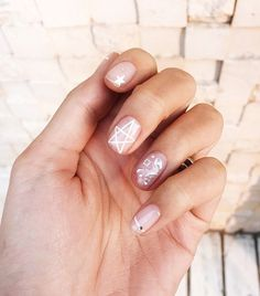 Chriselle Lim's nail art with neutral colors