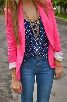 Navy and white polka dot top + bright pink blazer and gold jewelry