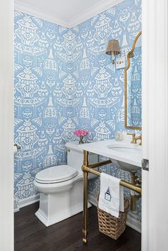 Covered in Hicks The Vase Wallpaper, this well designed white and blue powder room boasts a brass base washstand fitted with a white quartz countertop fitted with a vintage hot and cold faucet. Powder Room Wallpaper, Bathroom Wallpaper, Bathroom Colors, Small Bathroom, Bathroom Ideas, Bathrooms, Bathroom Inspo, Bathroom Interior, Blue Powder Rooms