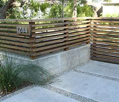 cmu wall with horizontal fencing and address