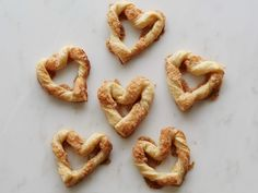 Shape ropes of puff pastry or pizza dough into hearts; brush with egg wash and sprinkle with cinnamon sugar before baking. Go over the top with a dipping sauce of warmed chocolate syrup or lavender honey.