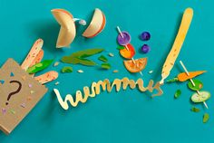 """Illustration by MaricorMaricar: """"A little paper illustration forAnorak Magazine'sFood Is Fun project. We created a packed lunch bursting with fortune cookies, vegie and fruit kebabs and bread sticks with hummus""""."""