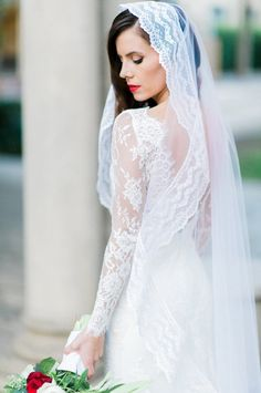 Stunning lace mantilla veil: http://www.stylemepretty.com/california-weddings/pasadena/2016/05/30/these-marines-winter-wedding-is-the-royal-wedding-2-0/ | Photography:Brett Hickman Photographers - http://bretthickman.com/