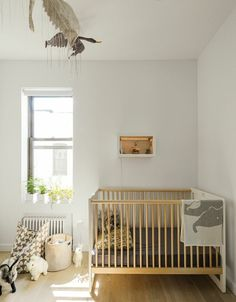 Baby room set up cot plants toys