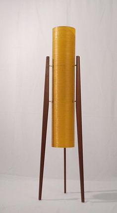 1960's floor standing Rocket Lamp. Admittedly a bit of a cliché, everybody has one but it is a design classic - simple and clean. Modernist interiors can sometimes be quite cold with the white wall and this lamp really helps to add some warmth to a room with its soft orange glow when lit. Really makes a mid-century modern minimalist house feel like home.