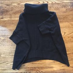 Listing - Poncho Style Turtleneck Sweater Black turtleneck sweater that fits wide and loose like a poncho. Sleeves come to elbow. Side slits and ribbed knit design on sleeves and neck. Normal wear. Also available in cream.  Bundle with other items to save on shipping. Old Navy Sweaters Cowl & Turtlenecks