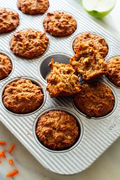 These hearty apple-carrot muffins are a perfect grab-and-go breakfast or snack! They're gluten free and naturally sweetened. #applecarrotmuffins #glutenfree #glutenfreebaking #grabandgo #cookieandkate