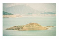 jimbonzo079 posted a photo:  Lake Kremasta - Greece - 17/8/2007  Lake Kremasta is the largest artificial lake in Greece. The construction of Kremasta Dam was completed in 1965 concentrating waters from four rivers: Acheloos, Agrafiotis, Tavropos and Trikeriotis. The water that is accumulated in the artificial lake is about 3.8 cubic kilometres.  Canon Powershot A710is