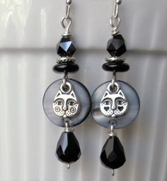 Silver wire black teardrop crystal & glass beads with cat face charm on black MOP drop dangle earrings. Please visit my ebay page to see all of my earrings for sale: www.ebay.com/...?:: Jewelry Ideas, Diy Jewelry, Jewellery, Beaded Earrings, Drop Earrings, Homemade Jewelry, How To Make Earrings, Cat Face, Chainmaille