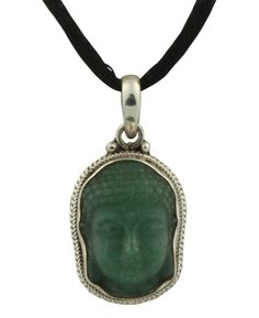 Handmade Buddha pendant made of sterling silver and green jade gemstone. Made in Nepal, available at BuddhaGroove.com.