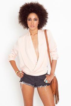 Peach twisted blouse... I love this, but would dress it up more than this. This would look so much classier with nice white summer slacks and some heels. $58