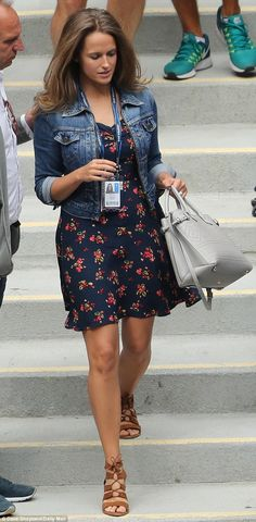 Flower power: Kim Murray looked pretty in a floral dress as she arrived on court…