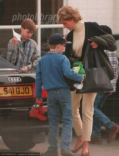 March 3, 1995: Princess Diana takes Prince William and Prince Harry to train with English Rugby Squad in Twickenham Stadium.