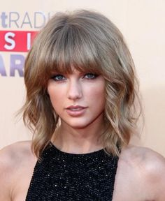 Taylor Swift seems to nail any beauty trend she tries, and this one is no different. Check out her staple winged liner and blunt bangs! #Celeb #Style