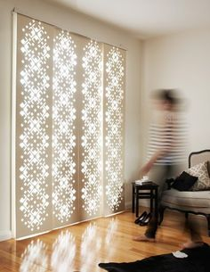 Deco Glide Window Screens - laser cut panels made of wood or synthetic materials and hung on a special track.
