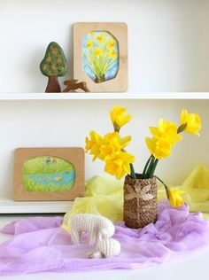 spring nature table, a framed picture for each season, corresponding silk and something (flower, stick) in a natural vase and a seasonal figure would be simple to get out each week.