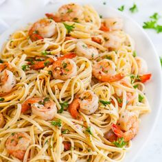 Shrimp Scampi Linguini - 20 minute classic Italian shrimp dish on top of a bed of linguini pasta with a lemon, white wine and butter sauce.