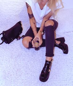 Black Ripped Jeans, Plain White Tee & Tattoos.