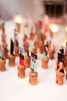 love this idea for escort cards - use wine corks tho - photo of each person attending ... maybe could have them find their car, then add the photo to a book & write a message
