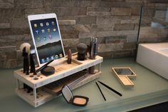 Charge multiple devices while you get ready for your day with this lovely bamboo makeup organizer!