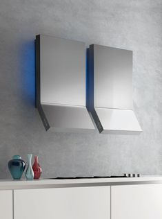 These wall-mounted Rialto extractors from Falmec are made from Fasteel, a fingerprint resisitant material. falmec.co.uk #kitchen #utopiamag