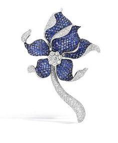 A Diamond and Sapphire Brooch.