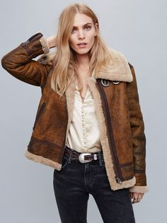 Aviator Sherpa Coat | In a luxe washed suede this aviator style jacket is lined with a super comfy and soft Sherpa. Rugged zipper pockets and adjustable belt detailing on the waistband and neck. Front zipper closure.