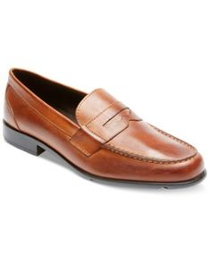 Embrace traditional looks with these timeless leather penny loafers from Rockport. | Leather upper; man-made sole | Imported | Lightweight | Rockport men's penny loafers | Moc toe | Brand detailing on