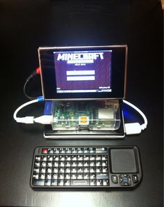 """Portable Minecraft Pi    """"It's the raspberry pi with a clear case from mcmelectronics, a 3.5 inch TFT monitor, iRulu 10,000mAh battery, and FAVI wireless keyboard from Amazon. Both the monitor and pi run off the battery, which outputs 5v at 2.1amps. I had to open up the monitor and solder the red wire to a point on the board where it reads 5v on a multimeter in order to get it to run off the battery. """""""