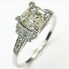 Asscher to a T:  The precise angles of the diamond frosted mounting provide a perfect foil to the stunning asscher cut center diamond. Beautifully balanced, crisp, and graceful. Ca.1925 Maloys.com