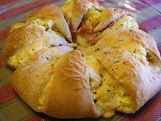 crescent rolls, eggs, bacon, cheese-