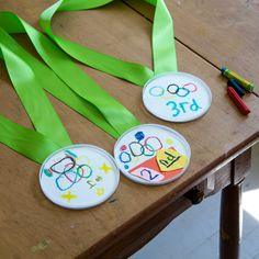How to make your own DIY Olympic medals for kids that they can decorate themselves. Plus a quick and easy way to make your own Olympic Games poster.