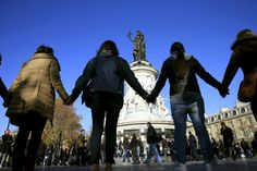 Photos of People hold hands to form a human solidarity chain near the site of the attack at the Bataclan concert hall in Paris, November 15, 2015. (REUTERS/Pascal Rossignol)the day - November 15, 2015 -