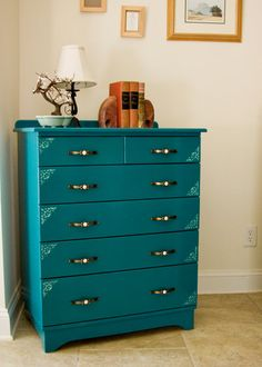 """I love this turquoise dresser. That color is amazing.  In a big enough room, you can have """"his and hers"""" dressers.  This would be the """"hers"""" due to the pretty floral on the drawers. But I'm thinking that turquoise might be a good color for a mirror frame, over the """"his"""" dresser, to mix it up."""