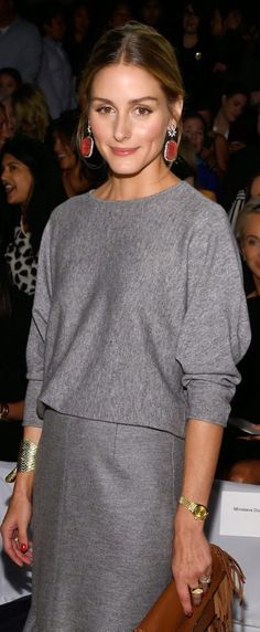minimalist; grey sweater with batwing sleeves + grey skirt/jeans. With black or silver jewelry.