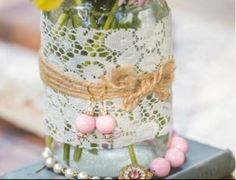 Our bride made these vases herself! They went perfect with her vintage theme.