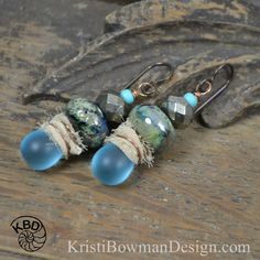 "Oceana, Lampwork Glass beads, faceted pyrite, glass drops and Sari Silk wrapped with Copper Wire to pulll it all together. These earrings measure approximately 2"" from the top of the Niobium Earwire. See more Finished Jewelry [HERE](https://kristibowmandesign.etsy.com) in my Etsy Shop. Lampwork Headpins by Judith Billig"