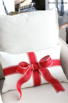 Turn an everyday pillow into a Christmas one with a little ribbon