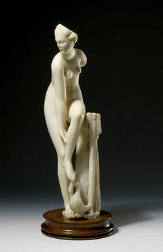 Marble statue of Aphrodite Euploia; left foot raised for removal of sandal and resting on head of swan; ship's rudder at side. Hellenistic 2ndC BC