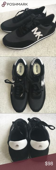 MICHAEL KORS sneakers    NWOT/Authentic Black and White sneakers with MK logo by Michael Kors. trades Reduced from $98 Michael Kors Shoes Sneakers