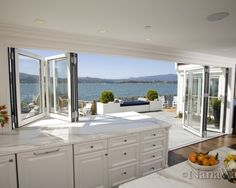 Kitchen windows doors to deck patio - Love that the window opens to make the kitchen counter indoor outdoor