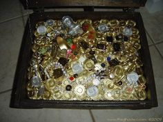 """How do you make a (seemingly) huge amount of treasure on the cheap? I <3 the method shown here... """"I've had several boxes of plastic poker chips forever and have NEVER used them, so I decided they would make good treasure. I hot glued them onto a piece of foam, and then spray painted them gold."""""""