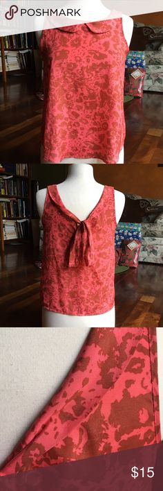 Patterned Tie-back Blouse Patterned Tie-back Blouse. *Size unmarked but fits like a small. *Coral with brown pattern. *Excellent condition, only flaw is a few loose threads as pictured in last photo. *Please don't hesitate to ask questions! *Always open to offers! Tops Tank Tops