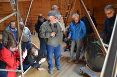 January 28, 2014 - Everyone is eager to get a picture of the Clark Telescope lens cell once it is lowered to the ground.