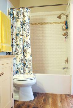 DIY Master Bathroom -- Wood look tile floors, new vanity, subway tile shower, pivot mirror!