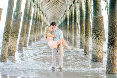 Under the pier at FOLLY BEACH!!  CHARLESTON, SOUTH CAROLINA ENGAGEMENT PHOTOS by wedding photographers, Aaron and Jillian Photography // Hair & Makeup by Ash & Co Bridal
