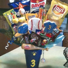 Baseball Candy Bouquet ...I made these for Senior Night as gifts to the Seniors! The cap, baseball, and numbered shirt are cookies.